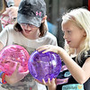 (Brad Davis/The Register-Herald) Skylar Bailey, 10, left, and Zeva Calloway, 8, win hamsters to take home in during Kids Classic Sunday.