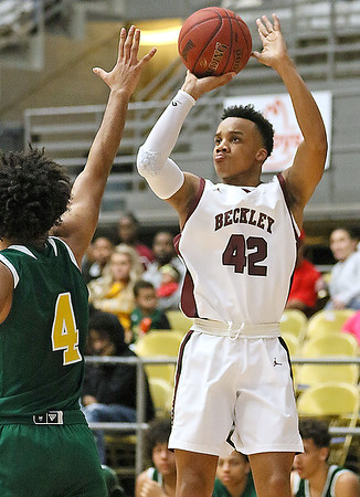 (Brad Davis/The Register-Herald) Woodrow Wilson's Richard Law pulls up for a jump shot as Huntington's Kris Brown defends Wednesday night at the Beckley-Raleigh County Convention Center.