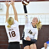 (Brad Davis/The Register-Herald) Shady Spring's Olivia Barnett spikes the ball as George Washington's Faith Smith tries to block during Shirley Brown Tournament action Saturday at Woodrow Wilson High School.