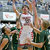 (Brad Davis/The Register-Herald) Greater Beckley Christian's Thad Jordan drives and scores through four Notre Dame defenders Saturday night at the Little General Battle for the Armory.