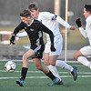 (Brad Davis/The Register-Herald) Winfield's Braxton Vanscoy, left, beats Fairmont Senior defenders Seth Stilgenbauer, middle, and Isaac Branch to break away and score a first-half goal Friday evening at the YMCA Paul Cline Memorial Sports Complex.