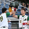 Michael Pineiro, of WV Miner, left, taps helmets with Will Harless after Harless hit a homerun against Normal CornBelters Tuesday evening at Linda K. Epling Stadium in Beckley.<br /> (Rick Barbero/The Register-Herald)