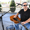 Randy Gilkey who is totally blind, playing his guitar during White Cane Safety Day held at Word Park in Beckley Tuesday afternoon.<br /> (Rick Barbero/The Register-Herald)