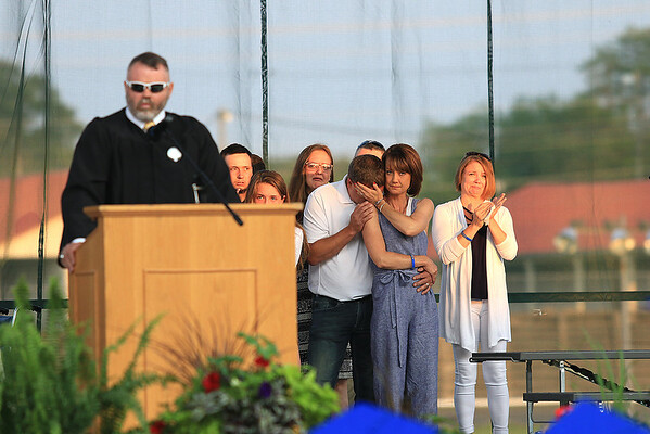 The family of Chad Ramsey, who died from injuries sustained in an ATV accident on May 19, grieves while receiving his degree for him during Greenbrier West High School's graduation ceremony in Fairlea Saturday. (Jenny Harnish/The Register-Herald)
