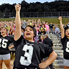 (Brad Davis/The Register-Herald) Westside cheerleaders, backed up by the Clearfork Crazies behind them, make noise for their classmates on the field during a road game at in-county rival Wyoming East Friday night in New Richmond.