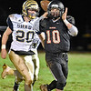 (Brad Davis/The Register-Herald) Liberty quarterback Ian Sloan turns to throw a pass as he's pursued by Shady Spring defender Issac Harvey Friday night in Glen Daniel.