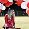 (Brad Davis/The Register-Herald) Liberty senior attendant Ashley McGraw smiles to waving friends and family as she rolls in to meet her escort on a custom float during homecoming festivities Friday night in Glen Daniel.
