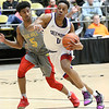 (Brad Davis/The Register-Herald) Crestwood Prep's Jahcobi Neath speeds around Oak Hill Academy's Evan Johnson defends during Big Atlantic Classic action Wednesday night at the Beckley-Raleigh County Convention Center.
