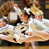 Woodrow Wilson's cheerleaders perform during first quarter of the boys basketball team's game against Spring Valley in Beckley on Tuesday. (Chris Jackson/The Register-Herald)
