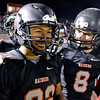 (Brad Davis/The Register-Herald) Liberty teammates Ryan Simms, left, and Clayton Williams have a few laughs on the sideline as they wait for the Battle of '76 against visiting Independence to get underway Friday night in Glen Daniel.
