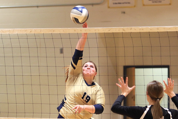 Greenbrier West's Reegan Lively (19) hits a strike agianst Greater Beckley Christian during the Class A Region 3 Section 2 volleyball tournament at Greenbrier West Tuesday. (Jenny Harnish/The Register-Herald)