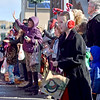 (Brad Davis/The Register-Herald) Attendees of all ages wave and anticipate candy during the Beckley Christmas Parade Saturday morning.