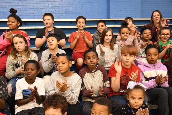 Students at Stratton Elementary School applaud after hearing the announcement that Gloria Clark, pre-k teacher  won the Reginald R. Rhodes Extraordinary Award. <br /> (Rick Barbero/The Register-Herald