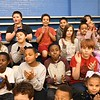 Students at Stratton Elementary School applaud after hearing the announcement that Gloria Clark, pre-k teacher  won the Reginald R. Rhodes Extraordinary Award. <br /> (Rick Barbero/The Register-Herald