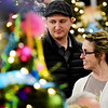 Wes and Jamie Carr, from Shady Spring, speaks with family as they look over Christmas trees during the 11th annual United Way of Southern West Virginia's Wonderland of Trees Auction at the J.W. And Hazel Ruby West Virginia Welcome Center in Mt. Hope on Friday. (Chris Jackson/The Register-Herald)