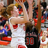 (Brad Davis/The Register-Herald) Greater Beckley Christian's Grace Mitchell drives to the basket as Oak Hill's Marcayla King defends Friday night in Prosperity.