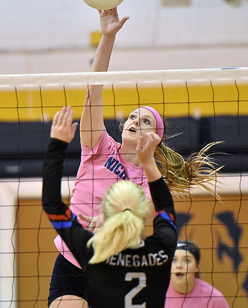 (Brad Davis/The Register-Herald) Nicholas County's Maggie Gadomski spikes the ball as Westside's Taylor Brown defends during the Coalfield Conference Volleyball Tournament Saturday afternoon at Shady Spring High School.