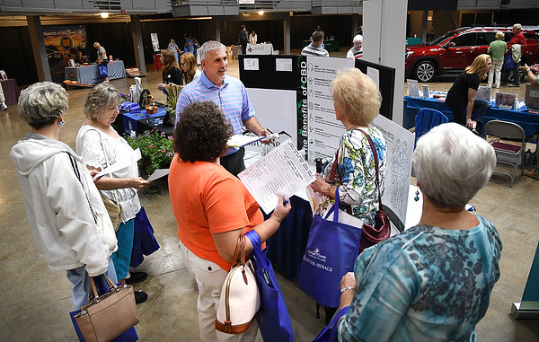 """Seniors listening to Jeff Brrooks, co-owner CBD Distributors, during, """"Senior Day Out"""" held at Beckley-Raleigh County Convention Center. The event had, music bingo, vendors, door prizes, information about products and services for our senior community and was co-sponsored by, The Register-Herald and Raleigh County Commission on Aging.<br /> (Rick Barbero/The Register-Herald)"""