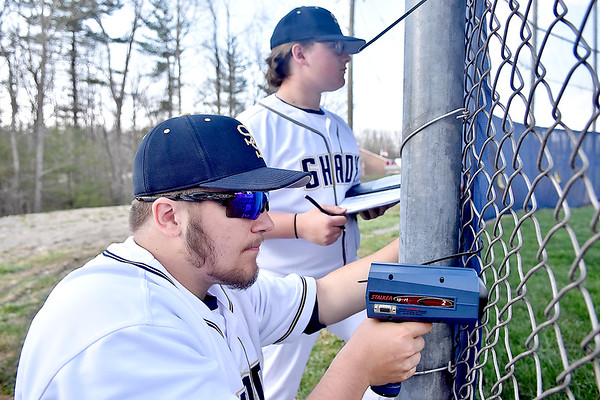 (Brad Davis/The Register-Herald) Shady Spring baseball players Ethan Morgan, near, and Aden Seabolt keep track of teammate Justin Lovell's pitching as Morgan uses a radar gun to check the speed and Seabolt jots it down as the Tigers play against James Monroe Wednesday evening in Shady Spring. Lovell's velocity, in case you're curious, was floating around the 75-80 M.P.H. range, according to these diligent scouts.