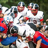Midland Trail's Colton Yoder gets taken down by the Oak Hill Red Devils defenders.<br /> Submitted photo by Sarah Garland