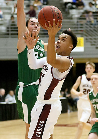 (Brad Davis/The Register-Herald) Woodrow Wilson's Richard Law glides in for a layup as Hampshire's Isiah Steinmetz defends during Big Atlantic Classic action Friday night at the Beckley-Raleigh County Convention Center.