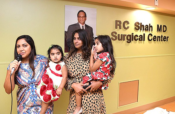Rina Shah Bharara, holding her daughter Savina, left and Disha Shah with her daughter Viya, speak about their late father, Dr. R.C. Shah, MD, during a Memorial Tribute and Dedication Cememony at Beckley ARH Hospital on Stannaford Road. <br /> (Rick Barbero/The Register-Herald)