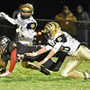 (Brad Davis/The Register-Herald) Liberty ball carrier Dustin Workman dives for the endzone to score a touchdown before Shady Spring defenders Jacob Showalter, left, Caleb Whittaker can tackle him Friday night in Glen Daniel.