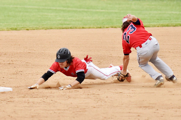 Oak Hill's Zane Wolfe beats the tag by Independence's Michael McKinney during their Class AA Region 3, Section 1 tournament game in Oak Hill on Thursday. (Chris Jackson/The Register-Herald)