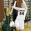 (Brad Davis/The Register-Herald) Woodrow Wilson's Liz Cadle drives to the basket as Wyoming East's Katie Daniels defends Saturday night in Beckley.