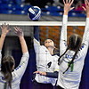 (Brad Davis/The Register-Herald) Shady Spring's Rylee Wiseman spikes the ball between Robert C. Byrd defenders Jordan Heckert, left, and Abigail Fazzini during State Volleyball Tournament action Friday afternoon at the Charleston Civic Center.