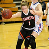(Brad Davis/The Register-Herald) Summers County's Bethani Cline battles to grab a rebound as Midland Trail's Meghan Gill defends Wednesday night in Hico.
