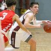 (Brad Davis/The Register-Herald) Woodrow Wilson's Bryce Radford moves the ball up through mid court as Parkersburg's Braeden Mason defends Friday night at the Beckley-Raleigh County Convention Center.