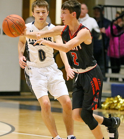 (Brad Davis/The Register-Herald) Liberty's Braden Howell dishes to an open teammate along the perimeter as Shady Spring's Tommy Williams pressures Wednesday night in Shady Spring.