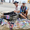 (Brad Davis/The Register-Herald) Swedish scouts Christoffer Frimodig, left, and Emil Gerdtsson sit with their vast collections of patches, each unique to their respective troop and location, spread across the rocks as they hang out in a pop-up trading area during the last day of World Scout Jamboree activities Thursday afternoon at the Summit Bechtel Reserve.