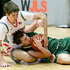 (Brad Davis/The Register-Herald) Greater Beckley Christian's Thad Jordan scrums for a loose ball with Notre Dame's Jaden West Saturday night at the Little General Battle for the Armory.