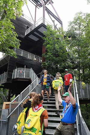 Frank McAllister, right, directs scouts into the Sustainability Treehouse during the World Scout Jamboree at the Summit Bechtel Reserve in Glen Jean.