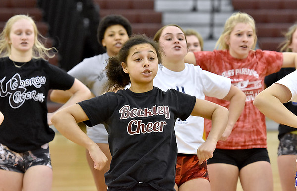 (Brad Davis/The Register-Herald) Woodrow Wilson cheerleaders work through their cheer routine in preparation for the upcoming state competition in Huntington during practice Wednesday afternoon.