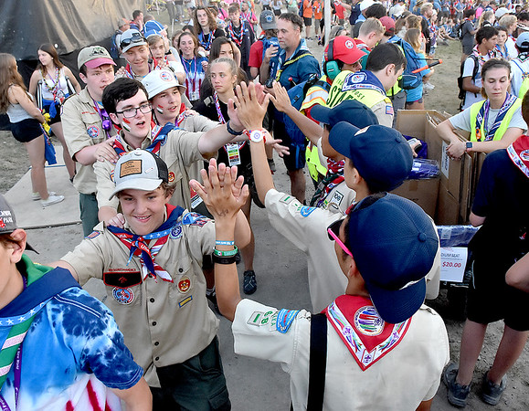 (Brad Davis/The Register-Herald) Scouts from all nations hih-five each other as they pass at the World Scout Jamboree's Cultural Celebration Friday night at the Bechtel Summit Reserve.