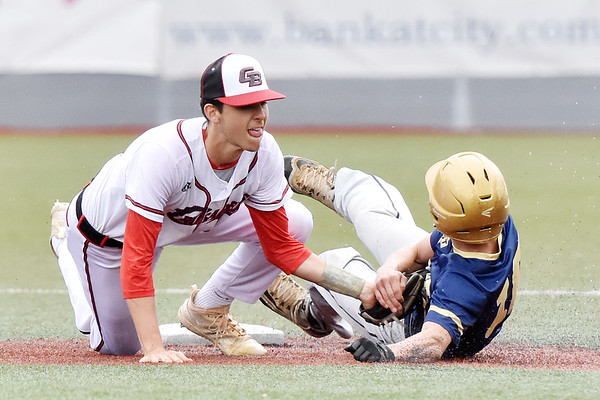Greater Beckley Christian's (20) tags out Greenbrier West's (10) during their baseball game in Beckley on Monday. (Chris Jackson/The Register-Herald)