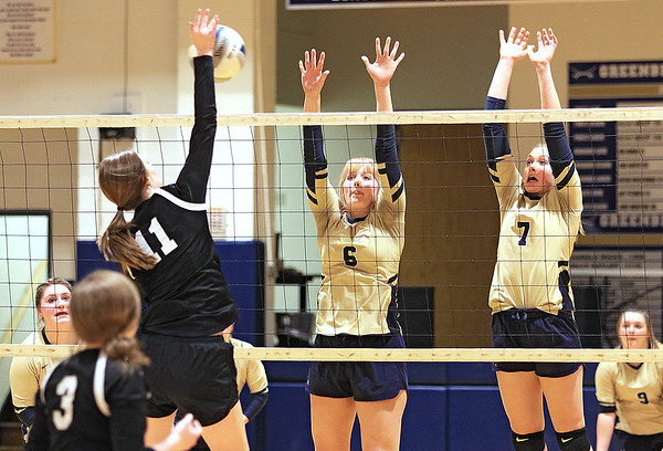 Greenbrier West's Kenzie O'Dell (6) and Kenley Posten (7) block an attempt by Greater Beckley Christian's Courtney Green (11) during the Class A Region 3 Section 2 volleyball tournament at Greenbrier West Tuesday. (Jenny Harnish/The Register-Herald)