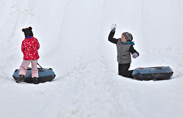 (Brad Davis/The Register-Herald) Snowballs begin to fly as best friends Alyssa Starnes (left), 9, and Bryn Holden, 10, both from North Carolina, get into a friendly shouting match over who won after the two finished up another run down the snow tubing track at Winterplace Saturday evening. If you were looking forward to playing in some snow, Winterplace was the only place to find it, as a winter storm system moving through the area largely spared us of any real accumulation.