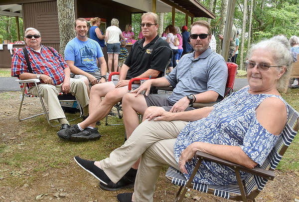 (Brad Davis/The Register-Herald) Ginger, far right, and Roger Lilly, far left, enjoy the day with all three of their sons (from left), Wesley Lilly of White Sulphur Springs, Chris Lilly of Shenandoah, Virginia, and John Lilly of Pasadena, Maryland during the 90th annual Lilly Reunion Saturday.