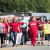 A group of teachers make their way during the Labor Day Parade in Pineville on Monday. (Chris Jackson/The Register-Herald)