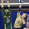 (Brad Davis/The Register-Herald) Greenbrier West's Logan Vandall spikes the ball as Paden City's Maggi Still defends during State Volleyball Tournament action Friday afternoon at the Charleston Civic Center.