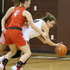(Brad Davis/The Register-Herald) Woodrow Wilson's Cloey Frantz tries to maintain possession under intense pressure at midcourt from Parkersburg's Kristen Lowers (#4) and Anna Umpleby Saturday afternoon in Beckley.