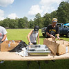 People work to break up pork during a pig roast during the annual UMWA Labor Day Celebration at John Slack Memorial Park in Racine on Monday. (Chris Jackson/The Register-Herald)