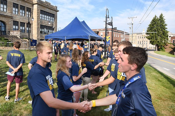 Over 300 hundred new students gather on the lawn of Carter Hall at WVU Tech on South Kanawha Street in Beckley Monday morning pick to up their t-shirts, learn about student life and talk about their orientation experiences. <br /> (Rick Barbero/The Register-Herald)