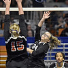 (Brad Davis/The Register-Herald) Greater Beckley Christian's Faith Brooks sends the ball back across as Wirt's Madison Richards defends during State Volleyball Tournament action Friday morning at the Charleston Civic Center.