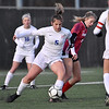 (Brad Davis/The Register-Herald) Morgantown's Caroline Stire separates Hurricane's Danielle Ray from the ball Friday evening at the YMCA Paul Cline Memorial Sports Complex.