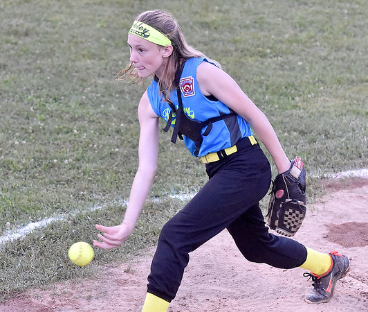 (Brad Davis/The Register-Herald) Beckley starting pitcher Savannah Bragg delivers against Hedgesville during Little League 8-10 year-old Softball State Tournament action Wednesday night at Affinity park in Midway.